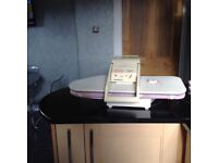 DOMENA steam ironing press with instruction book, pressing cushion and spare filter.