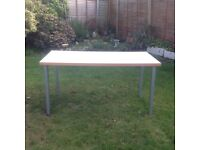 White table with silver legs