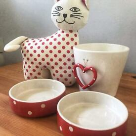 Cat food / water bowls, cat door stop and plant pot