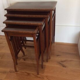 Edwardian Nest of Four Mahogany Tables with inlaid wood.
