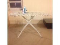 Iron, ironing board and clothes horse