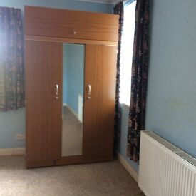 Lovely wardrobe with plenty hanging space and cupboard on top.
