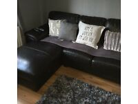 Brown leather corner sofa and tub chair