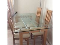 Solid glass and beech dining table and 4 chairs + matching coffee table and lamp table