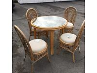 Cane table and 4 chairs cane table and chairs