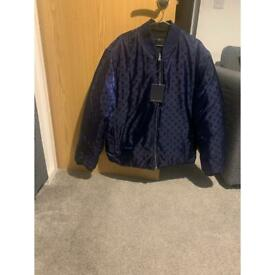 Louis Vuitton reversible jacket.