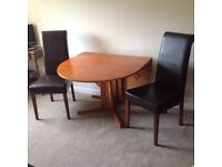 Drop leaf dining table and four dining chairs in good condition