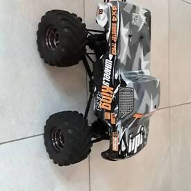 HPI Wheely king 4×4 RC Monster Truck with a NX86 delta peak AC/DC charger with spare battery