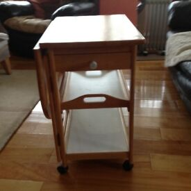 Drop leaf table ideal for use beside armchair or for small kitchen.