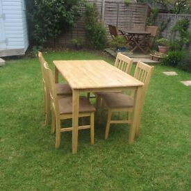 ## Wooden table and 4 chairs ##
