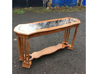 A Harwood Console Table With Glass