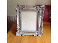 Ornate silver coloured pictur frame