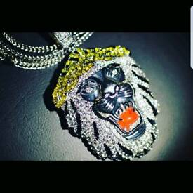 ICED OUT LION PENDANT AND CHAIN