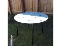 Free dining table with leave design.