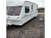 Lunar lexon EB fixed bed four berth touring caravan, well equipped.