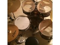 Complete adult Stagg drum kit with two zildjian cymbals, sticks and a practice pad