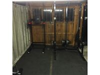 Great home/small gym set up including: dumbells 5-30 squat rack 150kg free weight olympic bar& bench