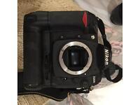 Nikon D200 + lens + battery grip + 2 batteries