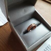 Rose gold engagement ring and wedding band for sale.