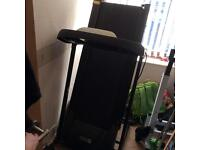 Electric treadmill folds up