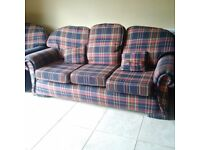3 seater tartan sofa and matching navy 2 seater for sale in reasonable condition and comfortable £20