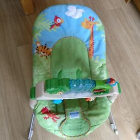 Baby Bouncer. Good condition. With music and vibration to soothe baby