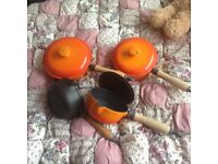 Set of old heavy saucepans