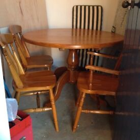 Pine round table With chairs.