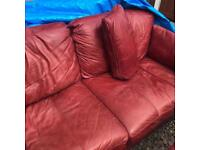 Genuine soft leather 3 seater sofa and a 2 seater burgundy colour