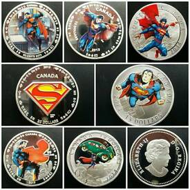 SET OF 7 SUPERMAN COINS
