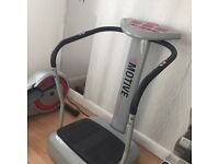 Motive vibration fitness machine