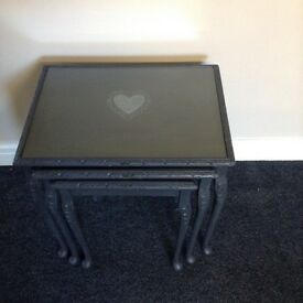 Nest of tables in grey with shabby chic heart design to the tops