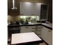 White Paula Rosa Satin Finished Kitchen Units with Mahogny Handles and Trim and Neff Appliances