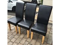 6 Black Leather Effect Skirted Chairs (Used- Good Condition)