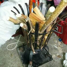 Metal outdoor log basket unused with vag logs.