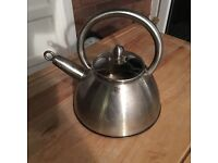 Stainless steel whistling kettle.