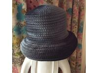 Lady's traditional greeny-grey hat.