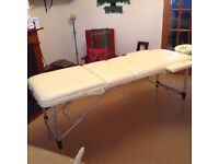 Cream folding massage bed with cover 1 yr old