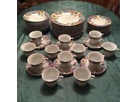 60 Piece dinner service, plates, bowls, cups. 12 setting