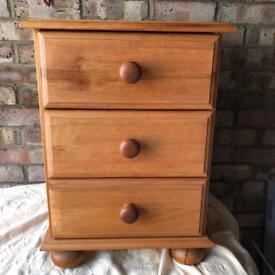 Small pine bedside chest of drawers