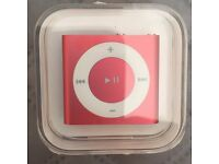 Brand new Apple iPod Shuffle 4th Generation 2GB - Red