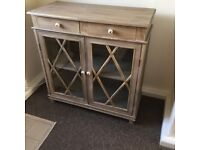 Lovely dresser in wood with criss cross detail on doors