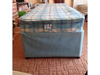Small single bed divan with sliding doors . Comes with mattress . In good condition. Need gone