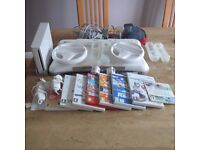 Nintendo Wii Bundle (all cables, nunchucks, wii fit board, games, wii motion & steering wheels)