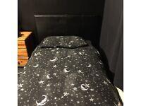 Black single ottoman bed frame