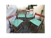 Four folding chairs with cushions