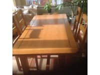 Large solid light oak table and four chairs