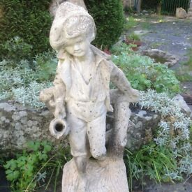 Garden statue male figure with water jug, can be used as a water feature.