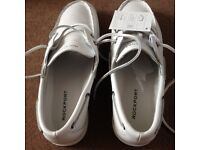Unworn and boxed Rockport boat shoes in white with white soles and laces