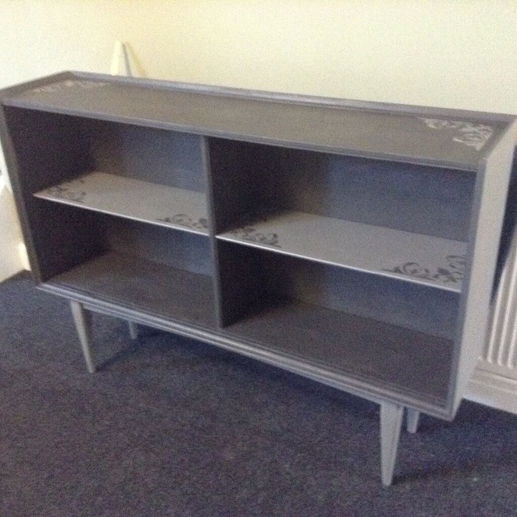 Long slim freestanding bookcase display and storage in grey with shabby chic pattern detail